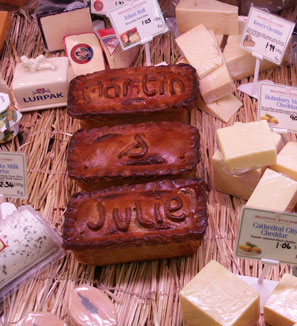 A selection of pies and cheeses